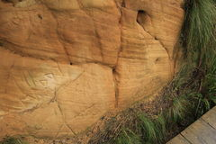 Etching on Rock Wall. Tourists defacing and damaging monuments by engraving graffiti and names on them Stock Photo
