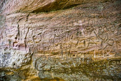 Etchings on sandstone cliff Stock Image