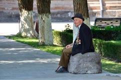 Free Etchmiadzin, Armenia, September, 16, 2014. Armenian Scene: A World War II Veteran Sitting In The Shade Of A Tree Stock Image - 66603161