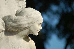 Eternal beauty. Profile of a beautiful young woman. This statue is part of the marble arch surrounding the statue of Johann Strauss in the Stadttpark, Vienna Stock Image