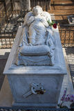 Eternal dream. Funerary sculpture in stone a figure hugging taken to a cross in the historic cemetery of St. Joseph of the city of Granada , Andalusia, Spain Stock Photography