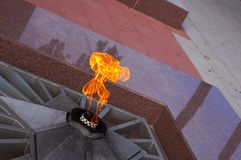 The eternal flame. Eternal fire on a memorial to the lost soldiers Royalty Free Stock Photo