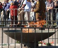 Eternal Flame. Burning with a soldier standing guard during Anzac day celebrations at the shrine of remembrance in Melbourne Australia to remember the soldiers Royalty Free Stock Image