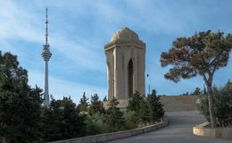 Eternal flame in the Alley of Martyrs, view on TV tower, eldar pine royalty free stock image