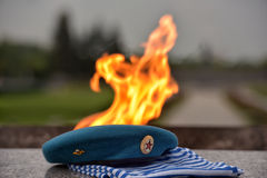 Eternal flame, blue beret and vest Stock Photography