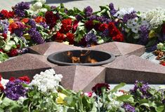Eternal flame with flowers assigned to it Stock Photo