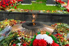 Eternal flame - with flowers. Eternal flame - with different colors and wreaths royalty free stock image