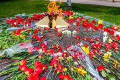 Eternal flame with flowers in memory of the victims of the Great Patriotic War 1941-1945 stock photos