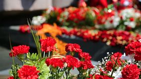 Eternal flame and flowers in memory of the Victory stock video footage