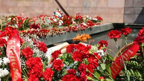 Eternal flame and flowers in memory of the Victory stock footage