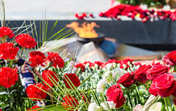 Eternal flame and flowers in memory of the Victory Royalty Free Stock Image