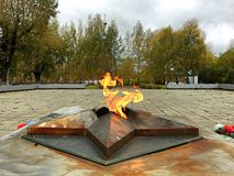 Eternal flame in front of the temple stock images