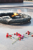 Eternal flame in honor of the fallen Soviet soldiers during the Second world war,. Red carnations Royalty Free Stock Images