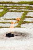 Eternal Flame, JFK, Arlington. The eternal flame at the grave site of JFK, 35th president of the United states, Arlington Cemetery, Virginia Stock Photos