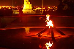 Eternal flame Kings Park. Close-up of eternal flame by night in Kings Park, Perth city, Western Australia. The flame of remembrance in the fountain, State War Royalty Free Stock Photos