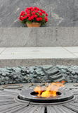 Eternal flame. Laying flowers at the eternal flame at the Walk of Fame of World War II. Kiev. Ukraine royalty free stock photos