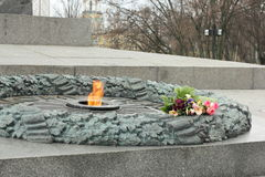 Eternal flame. Laying flowers at the eternal flame at the Walk of Fame of World War II. Kiev. Ukraine stock photos