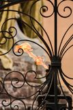 An eternal flame looking thru a wrought iron gate Stock Photo
