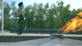 Eternal flame memorial and armed guard. 4K long shot