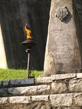 Eternal flame near patriotic statue Royalty Free Stock Image
