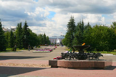 Eternal Flame soldiers-internationalists in square of Barnaul. Eternal Flame soldiers-internationalists and views of the city square and the administration of royalty free stock photos