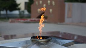 Eternal Flame - symbol of victory in World War II. Burning eternal flame and star at mass tomb of soldiers. `Eternal Royalty Free Stock Photography