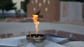 Eternal Flame - symbol of victory in World War II. Burning eternal flame and star at mass tomb of soldiers. `Eternal Royalty Free Stock Image