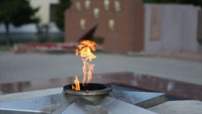 Eternal Flame - symbol of victory in World War II. Burning eternal flame and star at mass tomb of soldiers. `Eternal Stock Images