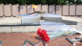 Eternal Flame - symbol of victory in World War II. Burning eternal flame and star at mass tomb of soldiers. `Eternal Stock Photo