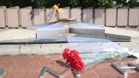Eternal Flame - symbol of victory in World War II. Burning eternal flame and star at mass tomb of soldiers. `Eternal Royalty Free Stock Images
