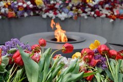 The eternal flame at Tsitsernakaberd, Yerevan, Armenia. Tsitsernakaberd, The Armenian Genocide memorial complex. The eternal flame at the center of the twelve Stock Photography