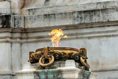 Eternal flame - Unknown Soldier Memorial - Rome Italy. Eternal flame for the Italian Unknown Soldier memorial at the Vittoriano or Altare della Patria Altar of royalty free stock images