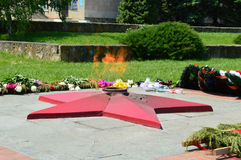 The eternal flame of the unknown soldier. Stock Photography