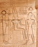 Eternal life. The ancient egyptian god of the underworld, Osiris, giving the gift of eternal life to Ramses II at the Ramesseum, Luxor, Egypt Stock Photos