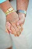 Eternal Love. A married couple hold hands royalty free stock photo