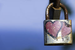 Eternal love concept. Hearts on rusty padlock Royalty Free Stock Photography