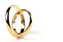 Eternal love. Two rings engraved with eternal love royalty free stock photos