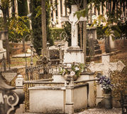 Eternal rest. Autumnal view of several graves in the old courtyard of the Catholic cemetery of Granada. Spain Royalty Free Stock Photo