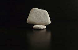 Eternal rocks and tranquility in the soul. A set of smooth stones on a black background, stacked in the order Stock Photos