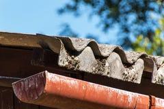 Eternal roof. Asbestos boards. Dangers of cancer. Hazardous waste. Eternal roof. Asbestos boards. Dangers of cancer. Hazardous waste Stock Photography