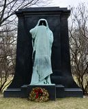 Eternal Silence. This is a Winter picture of a piece of public art as a gravestone marker titled: Eternal Silence located in Graceland Cemetery in Chicago royalty free stock photo