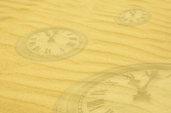 Eternity background - clock faces dissolving in sand Royalty Free Stock Images