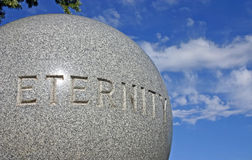 Eternity engraved around granite ball Royalty Free Stock Photos