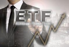 ETF é mostrado pelo conceito do homem de negócios imagem de stock royalty free
