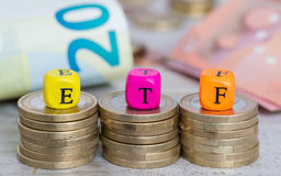 ETF letter cubes on coins concept.  Royalty Free Stock Photos