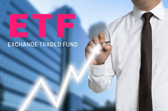 Etf trader draws market price on touchscreen Royalty Free Stock Images