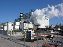 Ethanol Factory. Ethanol Manufacturing Plant Discharging Water Vapor Into The Sky Royalty Free Stock Photo