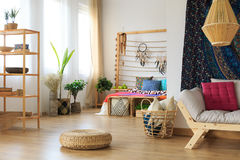 Ethnic apartment interior design. Ethereal ethnic multicolor roomy apartment interior design royalty free stock photography