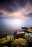 Ethereal Stillness II. A purple dawn with silky water effect Stock Images