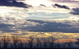Ethereal sunset cloud- and landscape Stock Photography